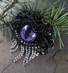 SOLD Gothic Steampunk Black Evil Eye Pin by twistedsisterarts, $149.95  I LOVE these. But this one is sold, so please don't buy it.