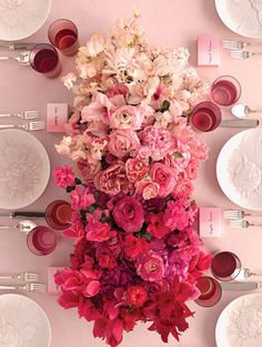 This pretty in pink centerpiece will command attention on your wedding reception tables.