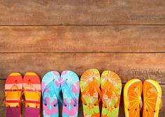 Photo about Brightly colored flip-flops on wood deck. Image of tropical, pretty, colorful - 14813173