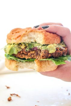 This California Burger is a big juicy vegan burger loaded with guacamole, fresh corn salsa, and sprouts. It's clean West Coast cuisine meets decadent burger Hamburger, Homemade Veggie Burgers, Vegetarian Recipes, Healthy Recipes, Diet Recipes, Vegetarian Grilling, Healthy Meals, Gluten Free Buns, Kitchens