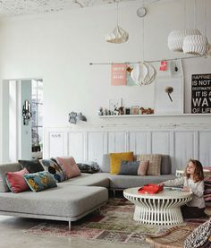 Tall ceilings, white, concrete floor, pops of color. Via Lobster & Swan.