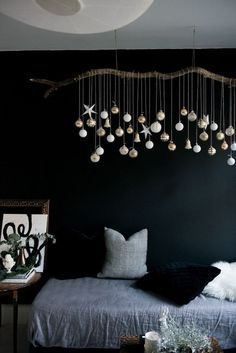 No space for a tree? Try this alternative. Take a branch, some string and some tonal baubles to create a festive garland instead.