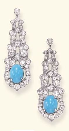 CARTIER - A PAIR OF ART DECO TURQUOISE AND DIAMOND EAR PENDANTS, CIRCA 1925. Each set with an old European-cut diamond collet, suspending an articulated series of graduated openwork old European-cut diamond links, terminating in a similarly-set openwork shield-shaped plaque, centring upon a cabochon turquoise, mounted in platinum, with French assay marks, signed Cartier Paris, numbered.