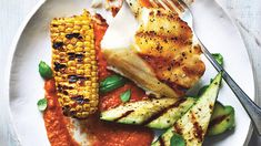Grilled Bass With Summer Veggies and Smoky Tomato Sauce | Get the easy recipe for Grilled Bass With Summer Veggies and Smoky Tomato Sauce.