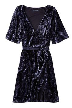 Office holiday parties, Secret Santa exchanges, tree trimming gatherings, New Year's Eve—you're holiday party calendar is stacked and we get it. To take the stress out of getting ready for all of these events, we've rounded up 35 of our favorite dresses on the market. Sequined minis, velvet wrap dresses, simple shifts, and everything in between. AEO Velvet Tie Dress, $30; ae.com