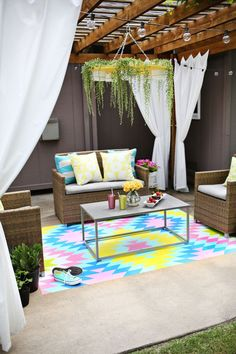 """Add some whimsical color to your patio area by painting a your own backyard """"rug"""" directly onto the concrete. This DIY from A Beautiful Mess uses vibrant neon colors to create an entrancing geometric design. See how at A Beautiful Mess » - HouseBeautiful.com"""