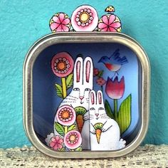 Using a tin box with a  window, create a mini magical world.  I used my own art printed on heavy paper, then cut out and glued in place.