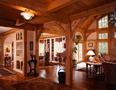 As evidenced by this space opening up to the great room, timber-frame homes don't need to rely on weight-bearing walls, allowing for a much more open feel throughout the home.