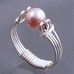 """Illusion Prong Ring (tut003). This quick and simple ring creates an illusion prong setting for a 6 mm bead. A modified version of this project was published in """"Contemporary Bead and Wire Jewelry"""" by Suzanne Tourtillott and Nathalie Mornu."""