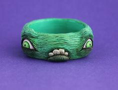 Monster creature bangle unique artist art jewellery sculpted sculpt resin jewelry teeth eyes funky odd weird cool awesome statement green