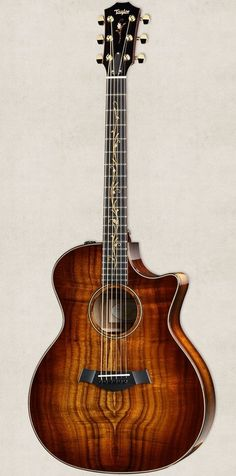 Really wanting this K24ce Taylor guitar right now! It has a bright and focused voice, warm overtones, and a lot of depth. Not the mention island vine fretboard inlay! What a beauty right?