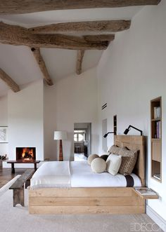 Designed by Pierre Yovanovitch, the master bedroom of a grand 17th-century château was decorated with natural elements in mind.   - ELLEDecor.com