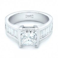 95f780db87b59d This stunning engagement ring features a princess cut diamond channel set  in white gold