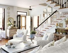 forever*cottage   Mirrors on the stairs , white walls, white slipcovers