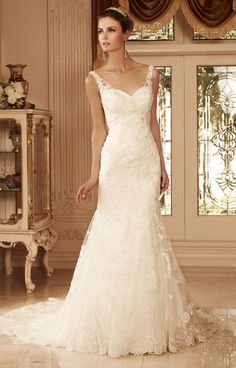 Casablanca 2099 displays a beautiful neckline outlined by thin lace straps and a sweetheart bust. The delicate lace is consistent from neck to train and adds drama to this already stunning fit and flare Casablanca gown.