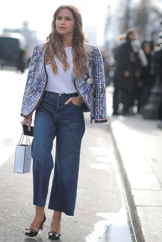 A tweed blazer paired with jeans and a tee.