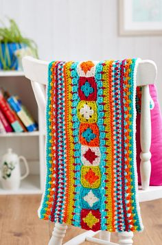 Summer Love Crochet Afghan Pattern | This crochet afghan pattern features a row of granny squares surrounded by rows of various stitches