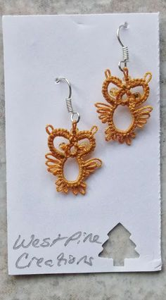 "Owl Earrings       Weekly challenge #19, In Tatters Tattbugg's, ""Owl for Needle Tatting"".   Tatted with Lizbeth, size 20, gold."
