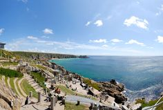 Minack Theatre in Cornwall, England. The link leads to a panoramic view of it! It's absolutely stunning!! Completely worth the days of suffering I did after with my souvenir sunburn!