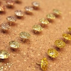 A little glitter and glue help to add some sparkle to a few plain thumbtacks.