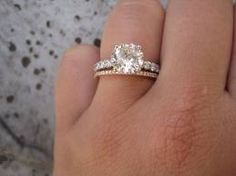 Mixed metals - white gold engagement ring + rose gold wedding band. Gorgeous!