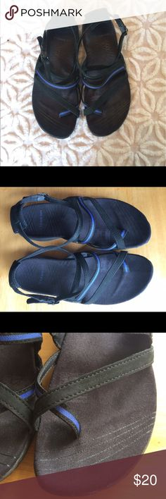 """MERRELL PERFORMANCE FOOTWEAR SIZE US 7 MERRELL performance footwear comfortable sandals in Size 7. The perfect sandal for adventuring this summer. The color is lilium black/Twilight blue.  Measurements: 9 3/4"""" long heel to toe. 3 5/8"""" at widest. 2 1/2"""" wide at heel. 1"""" tall heel. They are used but we're only worn a handful of times. Merrell Shoes Sandals"""