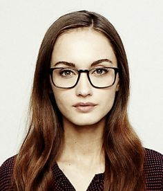 Bensen glasses by Warby Parker. They donate one pair to someone in need for each pair purchased.