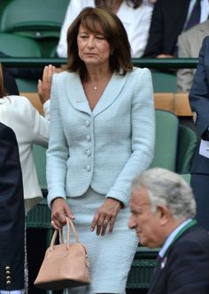 The Duchess of Cambridge's mother wore a pretty blue suit attending Wimbledon today in the Royal Box. June 27, 2014