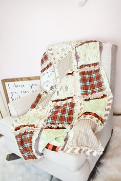 A fun baby boy woodland deer outdoor adventure themed rag quilt for your nursery decor needs. The quilt features leaves print, buffalo plaid, and a native american village with teepees and mountains The orange/mint combination makes this a modern take on a classic favorite for girls everywhere! Quilt measures 30x50 inc