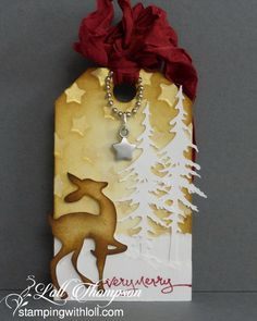 Mixed Media Christmas Tag . Love the addition of th little charm