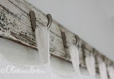 Cute idea for using reclaimed wood and hooks as a curtain rod!!!  DIY Curtain Rod - 5 You Can Make - Bob Vila