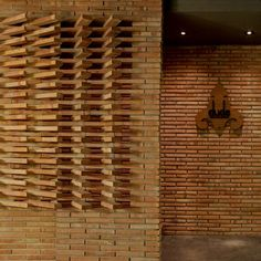 Thai architects Studiomake designed the bar, where cigars for sale are showcased inside a glass-fronted enclosure.