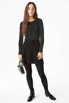 Dazzle in this slightly cropped, glittery, full sleeved top.