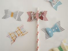 diy: lazos de papel Make your own paper bows. also with washi tape!