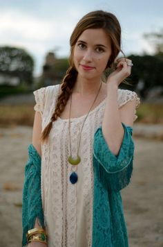Blue lace shrug over a lace dress and a long pendant necklace. Stunning.