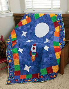 Dig into your scrap bin and begin sewing this adorable space-themed crib quilt today! Bright, primary colors and an appliqued rocket will make this a fan favorite for any future astronaut. Baby Boy Quilt Patterns, Heart Quilt Pattern, Baby Girl Quilts, Girls Quilts, Quilting Patterns, Quilt Baby, Quilting Ideas, Owl Patterns, Hand Quilting
