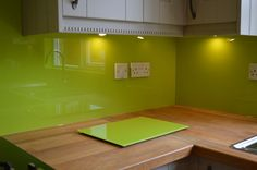 Lime Green Coloured Glass Chopping Board. View more Splashback-matching Accessories by CreoGlass Design (London,UK) on www.creoglass.co.uk #modernkitchen #interiors