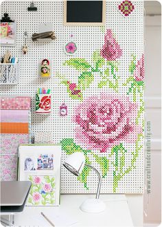 Get inspired and get organized with this room-brightening, clutter-banishing painted cross-stitch pegboard tutorial!