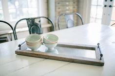 Use this tray as part of your centerpiece on your table, kitchen counter or even your coffee table! The wood frame with galvanized metal center immediately highlights whatever you choose to place on top!