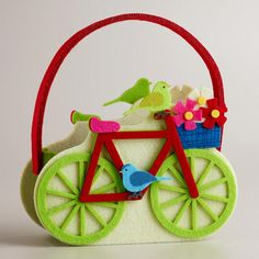 Our Felt Bicycle Container puts a fresh new spin on gift-giving this spring. This fun handled bag is lightweight and bursting with bright colors.