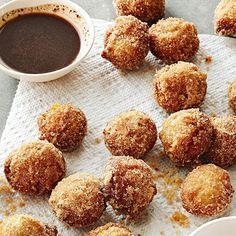This homemade doughnut hole recipe is the perfect dessert finger food at your party! Kids will especially love this sweet treat with a delicious caramel dipping sauce. The easy recipe can be made ahead of time to make your party prep less stressful.