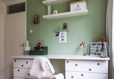 The desk consists of two IKEA drawer chests and an MDF board. The gold dots add a touch of glam.