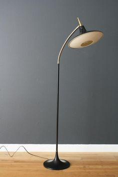 Mid-century atomic era floor lamp with saucer globe.