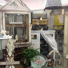 Vintage suitcases, European baby bath tub, toleware trays, garden statuary, antique windows and shutters...all available at The Antique Market Place in Greensboro, NC.