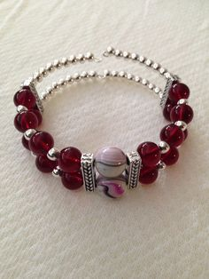 Burgundy memory wire bracelet with spacer bars.