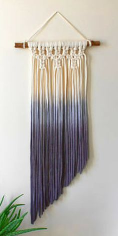 I love this gorgeous ombre Make a striking feature to any wall with this ombre dip dye macrame hanging. This handmade piece is made with recycled t-shirt yarn and locally sourced fallen wood. Hand knotted and hand dyed each one is completely unique to you! Affiliate link