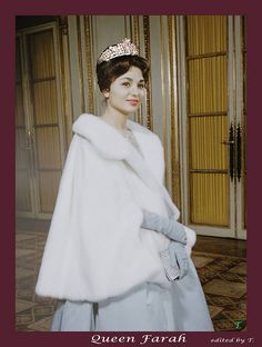 Farah Diba with white fur and diamond tiara.