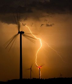 The blades of wind wheels are frozen by flashes of lightning in this long-exposure image from Jacobsdorf, Brandenburg, Germany. Tornados, Thunderstorms, Weather Storm, Wild Weather, Pictures Of Lightning, Thunder And Lightning, Lightning Storms, Lightning Flash, Lightning Strikes