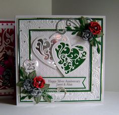 25th Silver Anniversary Card - used this same layout again for an anniversary card this time -  Using Dies from Spellbinders - Grand Squares, Vines of Passion (love this name for a heart), Bitty Blossoms, Labels Sixteen, Leaf from Botanical Swirls and Accents and Foliage, Tonic Studios - Scalloped Squares, DieNamics - FishTail Banners, A Nellie Snellen Heart and Crafts Too - Flourish. Embossing folders used are Crafters Companion - A4 Rose Swirls and Spellbinders A4 M-B'abilities Dainty…