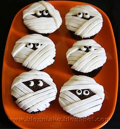 Google Image Result for http://www.cupcakepost.com/wp-content/uploads/2012/08/Mummy-Cupcakes.jpg